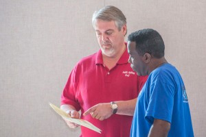 Tracey Webster of HealthMed, Inc., discusses health screening results with College Hill Baptist Church member Gary Heard.
