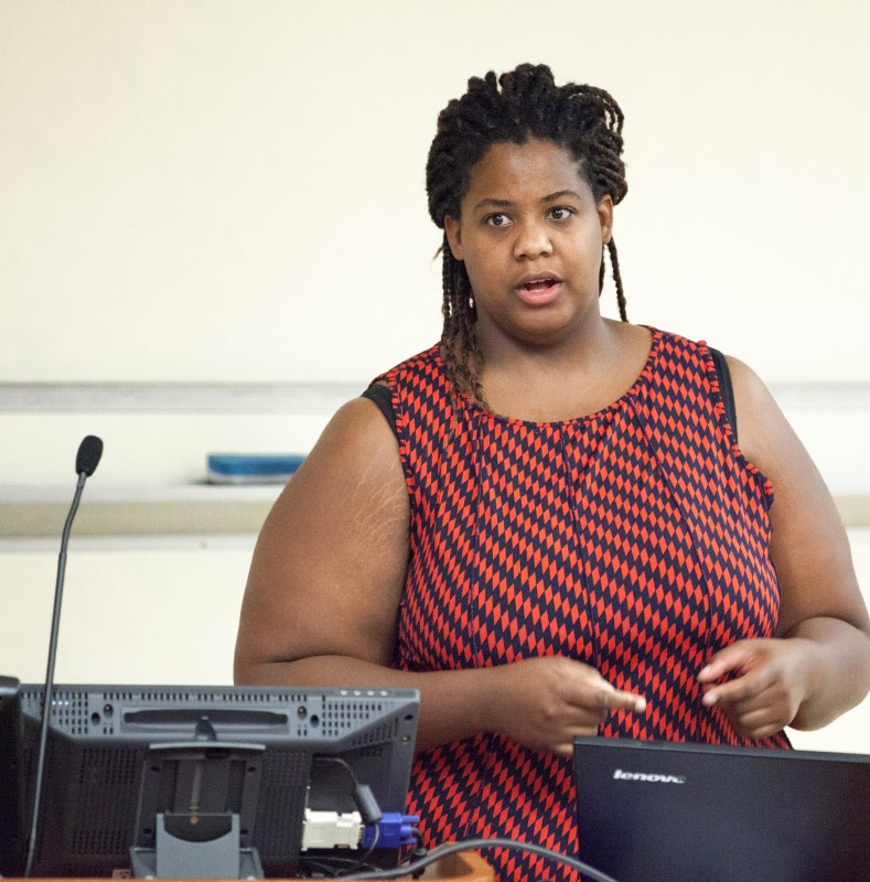 Pandora White tells of her personal experiences during a symposium overcoming stereotypes in career opportunities.
