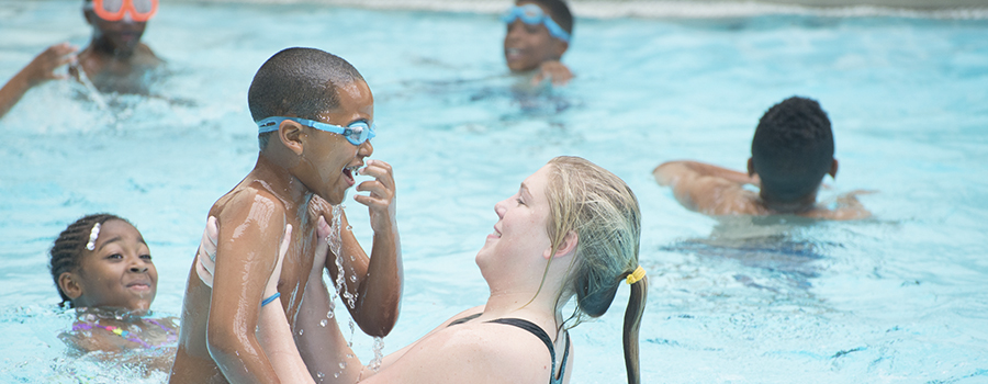 SWIM TO THE TOP CONNECTS UNIVERSITY STUDENTS WITH COMMUNITY MEMBERS through hands-on swimming lessons.