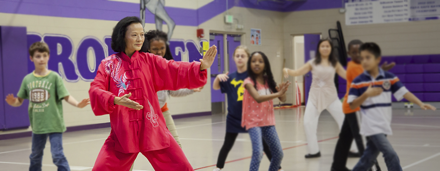 Ping Shi teaches Tai Chi to Holt Elementary School students for Heart Touch Program.