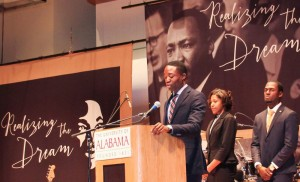 UA SGA President Elliot Spillers, Shelton State's Donielle Allen, and Stillman College's Christopher Ruffin welcome the 2016 Realizing the Dream audience.