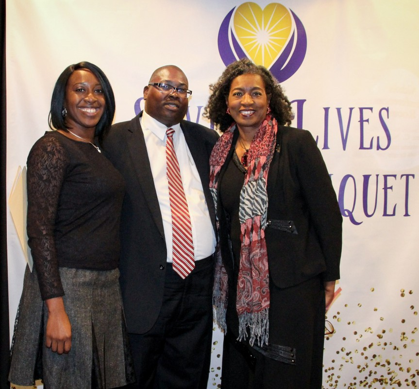 From left, Ms. Carol Agomo, Mr. Chris Spencer and Mrs. Coleen Ferguson, first lady of St. John Baptist Church, Tuscaloosa, pause for a photo at the third annual Saving Lives Banquet.