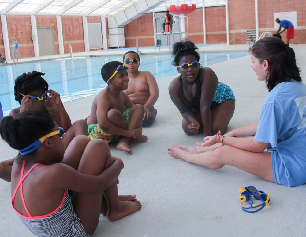 4321791d37 UA swim team member and Swim to the Top instructor Abigail Greenwalt  discusses swim safety with her group.