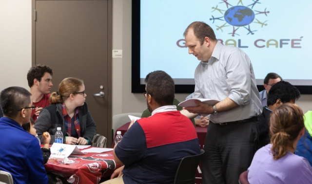 3Charter Morris, director of international services, distributes materials to help answer foreign students' questions.