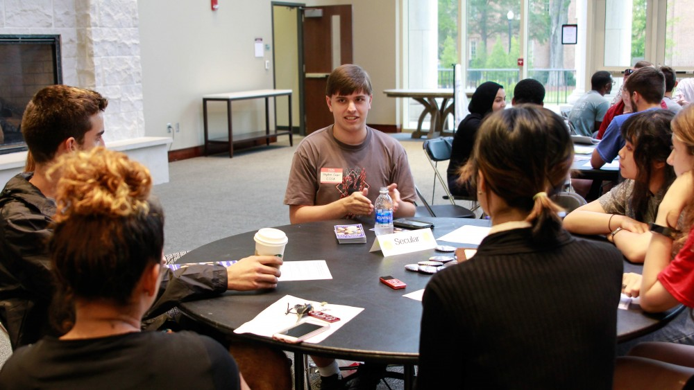 Stephen Cooper represents the Crimson Secular Student Alliance during the interfaith gathering.