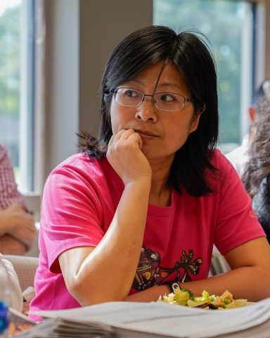 Wenjie Chai, visiting scholar in Social Work, listens to presentation at the October 12 Global Cafe meeting.