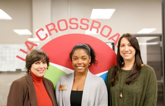 From left, Lane McLelland, Paige Bolden and Betsy Myers represent Crossroads Community Engagement Center on receiving the Sam S. May Award in October.