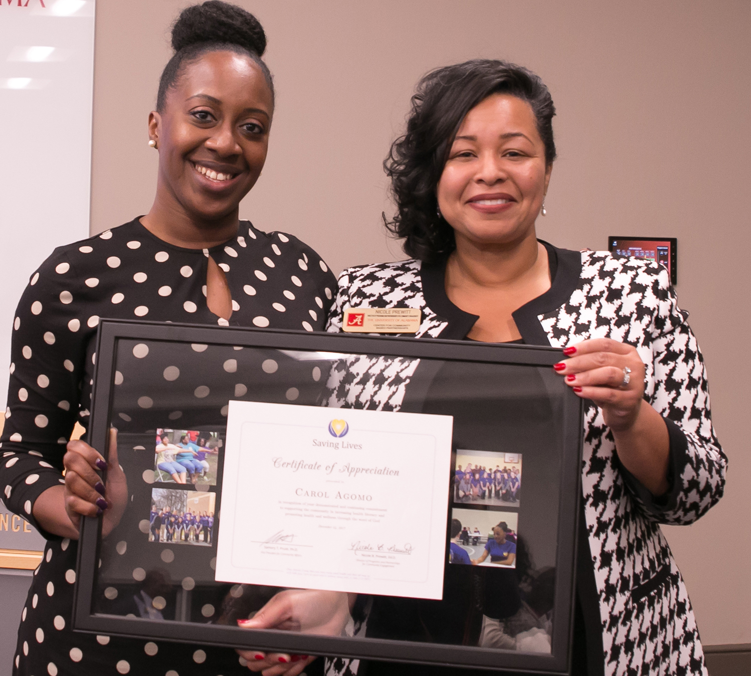 Carol Agomo receives a certificate of appreciation for her work with Saving Lives. With her is Dr. Nicole Prewitt, CCBP director of programs and partnerships for community engagement and director of the new Saving Lives Academy.