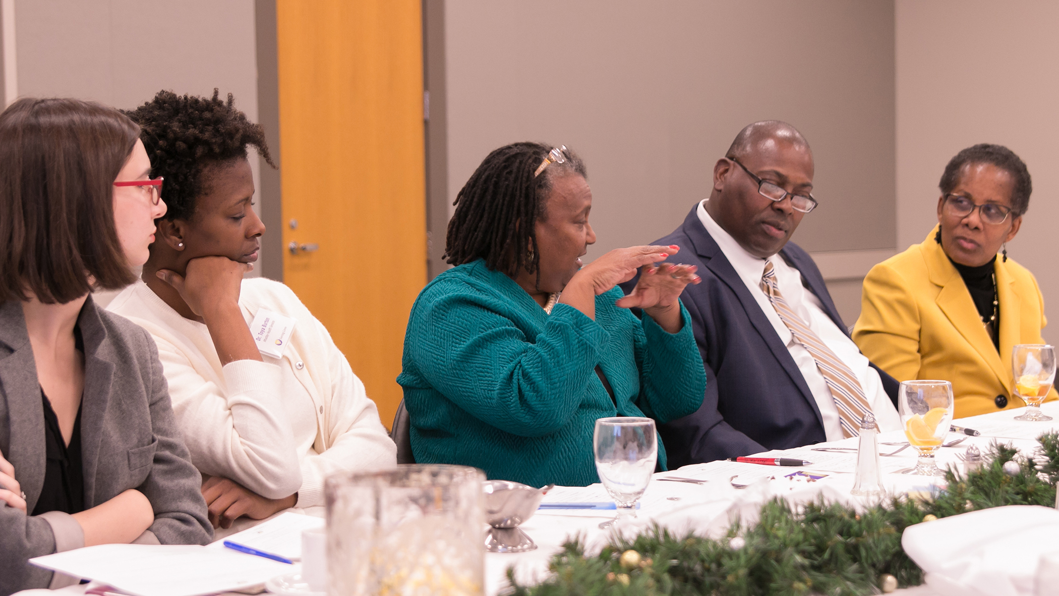 Dr. Pamela Payne Foster, center, makes a point about the design of a new Saving Lives Academy during the final Saving Lives meeting of 2017.