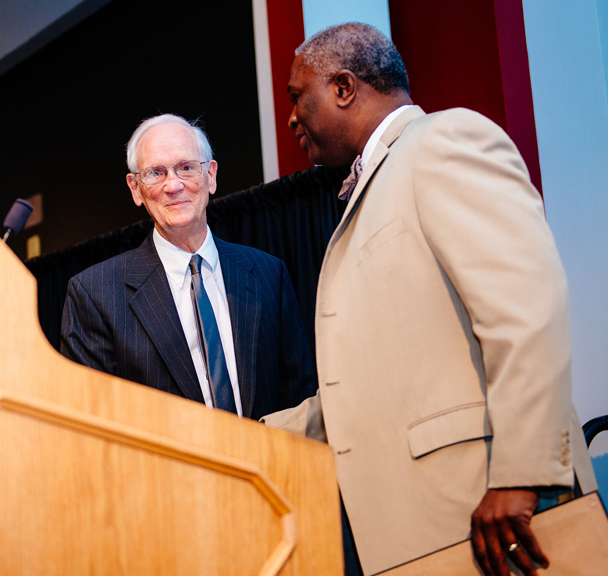 Dr. Samory T. Pruitt congratulates Dr. Ed Mullins on his award.