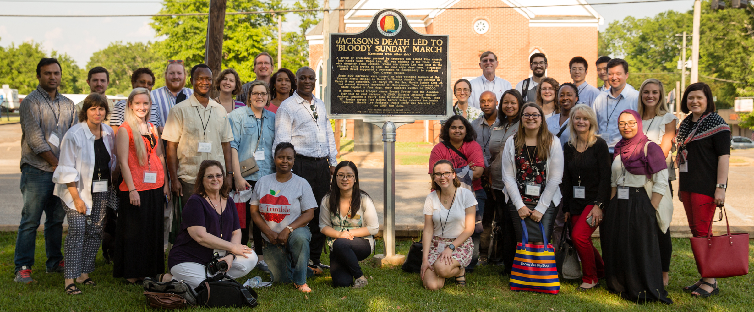 "Tour participants made a stop at the ""Bloody Sunday"" plaque commemorating the death of civil rights activist Jimmie Lee Jackson that occurred on March 7, 1965."