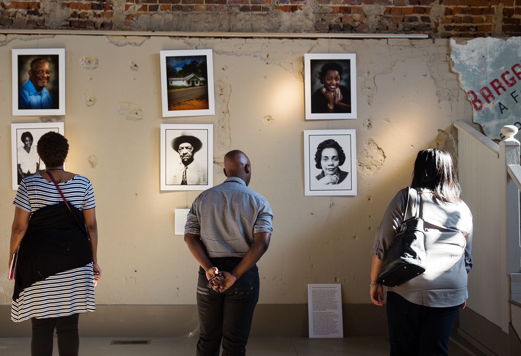 Viewers examine portraits of civil rights legends at the Smith Building Art Gallery in Marion, Alabama.