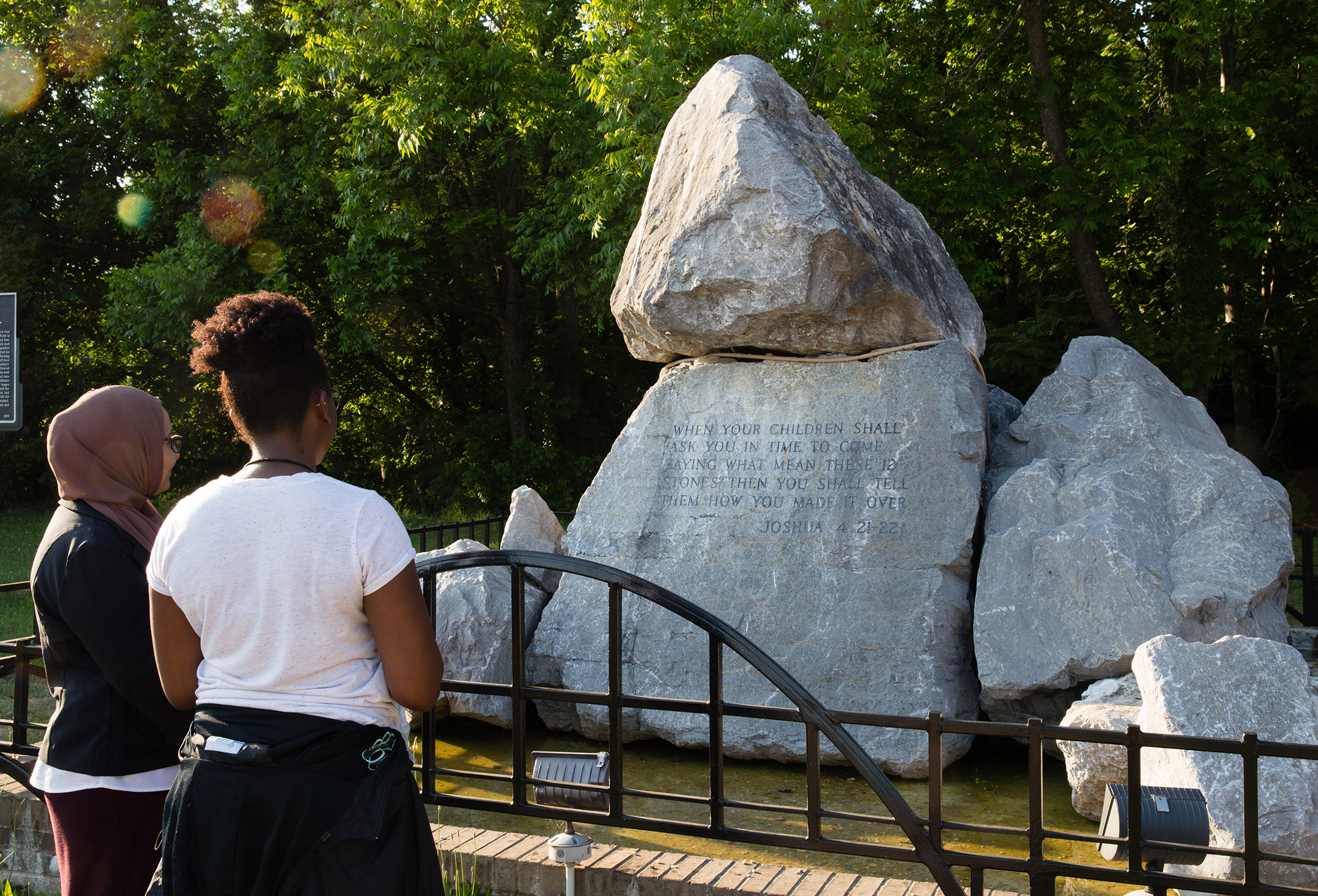 Tour participants view the rock sculpture located near the foot of the Edmund Pettus Bridge in Selma.