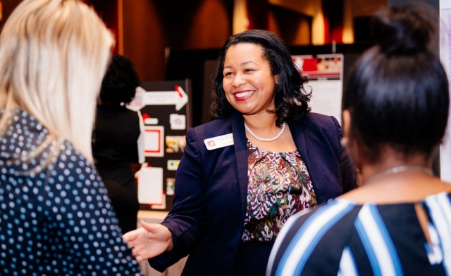 Dr. Nicole B. Prewitt and Awards Luncheon attendees admire the research posters at this year's Awards Luncheon.