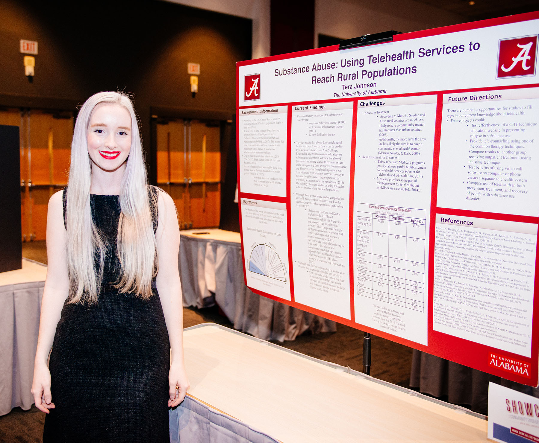 Tera Johnson displays her poster about using technology to reach rural patients.