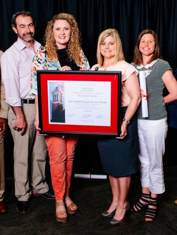 "The Community-Building and Sustainability Program Team of Tuscaloosa County School Systemaccepts the Excellence Award for Outstanding Community Partner-Initiated Engagement Effort for ""Support English Language Learners and Families."""