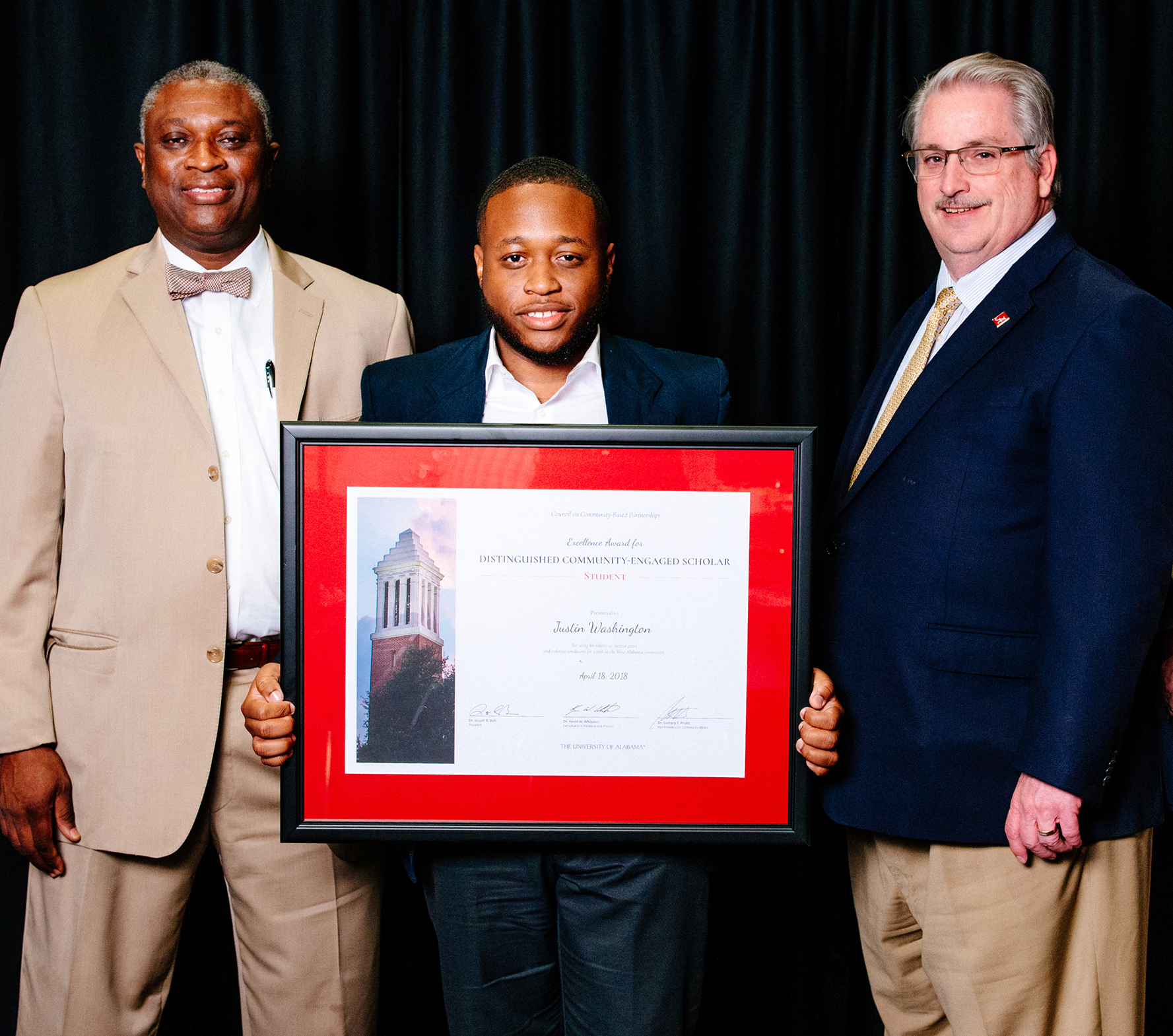 Justin Washington, MBA student, receives the Distinguished Community-Engaged Scholar Award– Student. Dr. Samory T. Pruitt is at left and Dr. John Higginbotham at right.