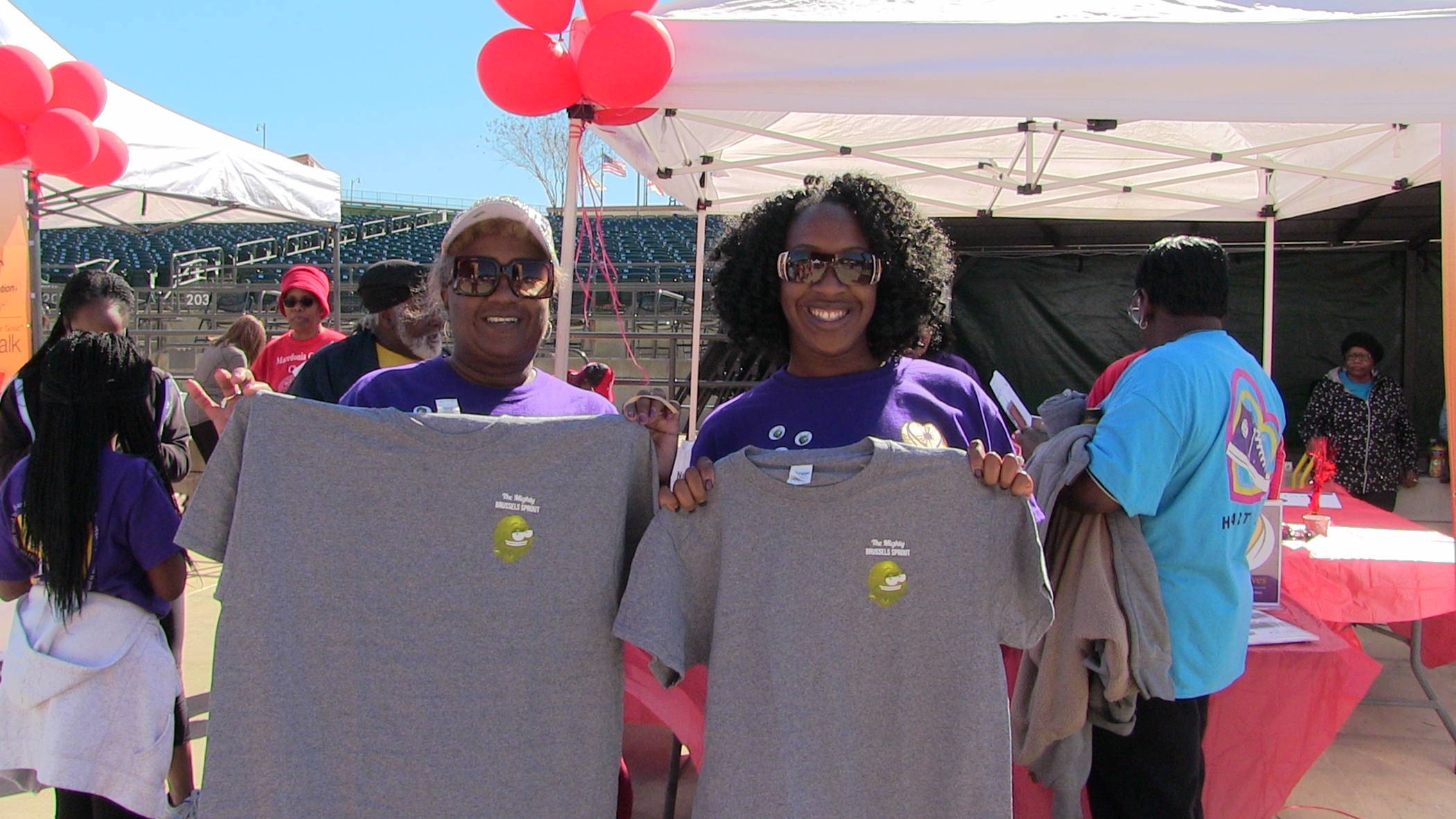 Carol Agomo and Annette Harris show off the T-shirts they won for completing the Brussels sprout challenge at Heart Walk 2018.