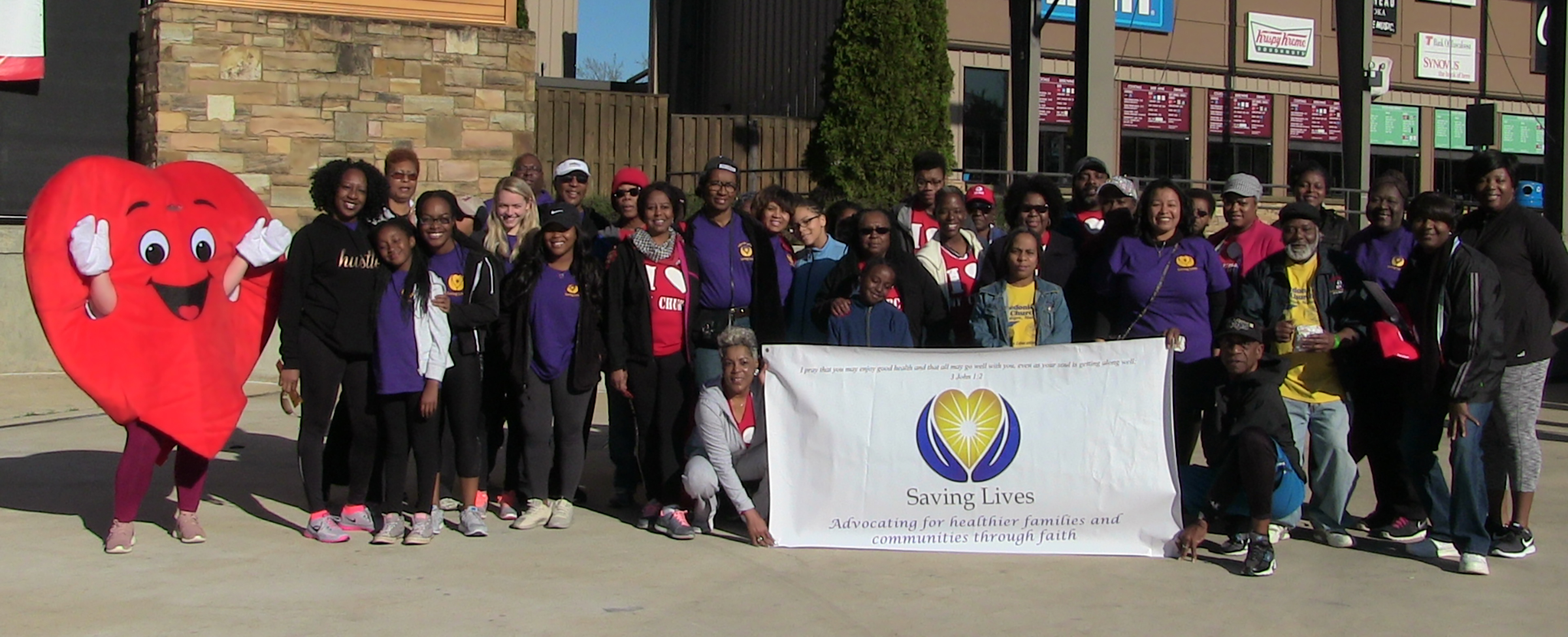 Saving Lives church members and the CCPB team pose for a group shot at the 2018 Heart Walk event.