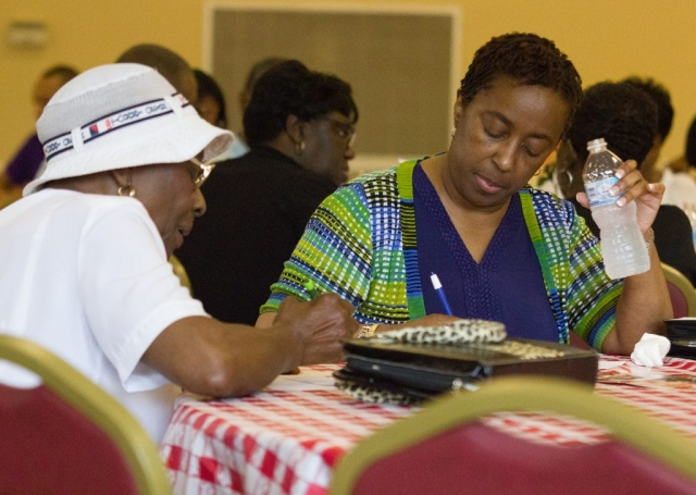"New Zion Missionary Baptist Church members take notes in the ""Senior Moments: Life Management Ministry"" in June."