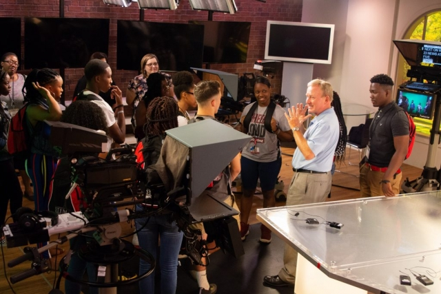 STEM Academy participants tour the WVUA studio and meet longtime newscaster Mike Royer, who now serves as managing editor at the studio, where he shares a lifetime of broadcast journalism experience and encouragement with students.