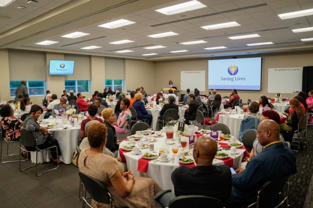 Faith communities enjoy dinner and networking during the Saving Lives event.