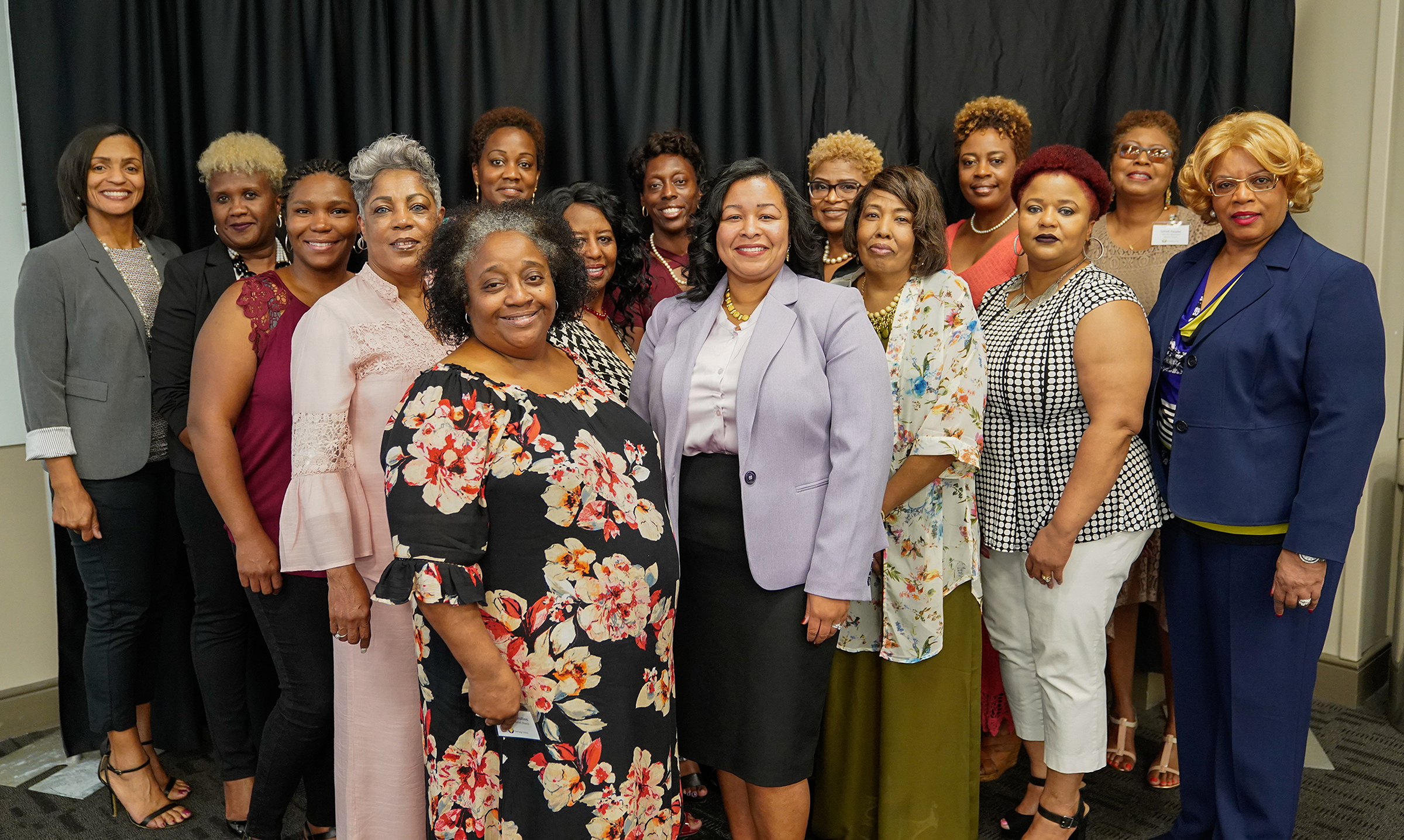 Saving Lives program director Dr. Nicole B. Prewitt, center, poses with Leadership Academy participants.