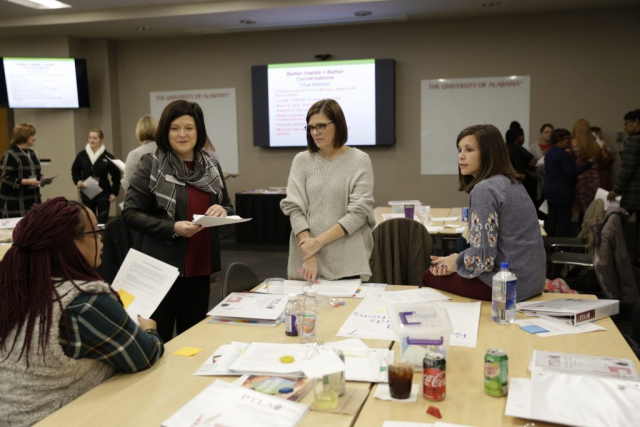 Dr. Holly Morgan, second from left, listens as teachers from Skyland, Oakdale, and Big Sandy Elementary Schools share classroom experiences.