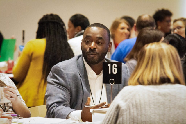 Marvin Williams, a parent from Collins-Riverside Middle School in Tuscaloosa County, discusses an idea during group work on the school's partnership project.