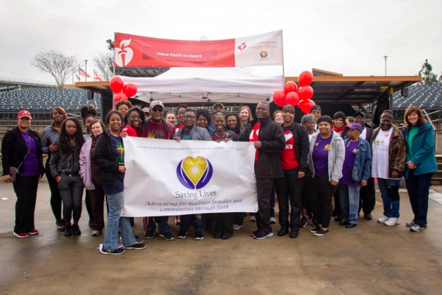 Saving Lives member church participants pose for a group photo at the 2019 Heart Walk.