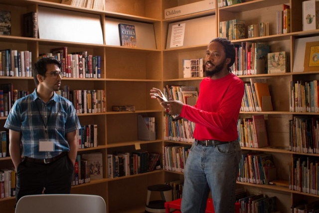 Caleb (red shirt), a Rural Studio student, conducted the tour of the Newbern Library.