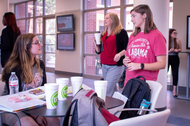 UA Honors Students engage in discussion about financial resources and housing stability at the HomeFirst retreat.