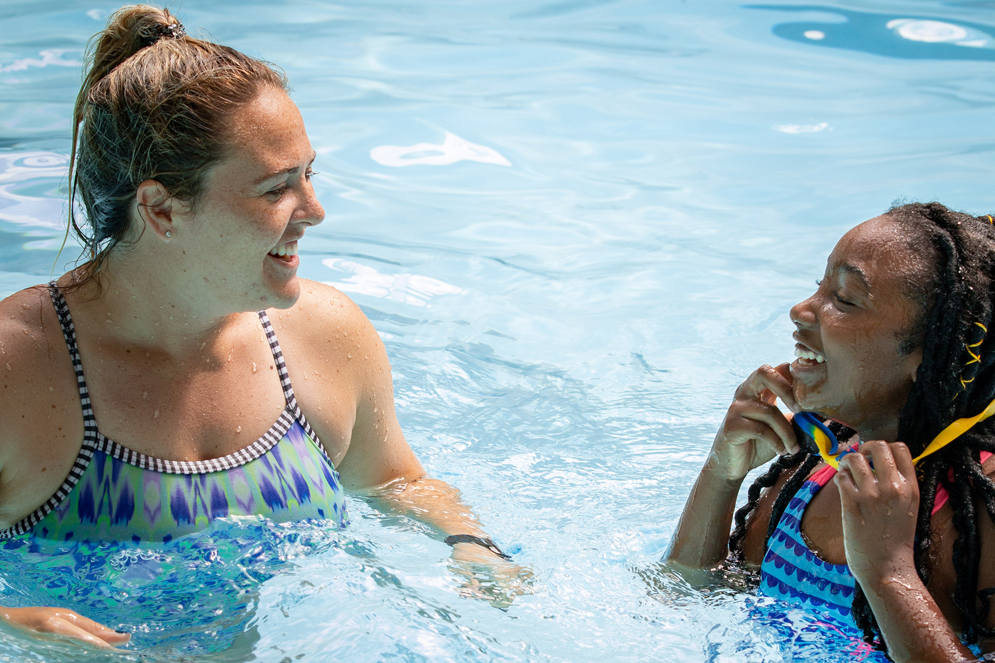 Program coordinator and swim instructor Daniela Susnara and child share a fun moment of learning.