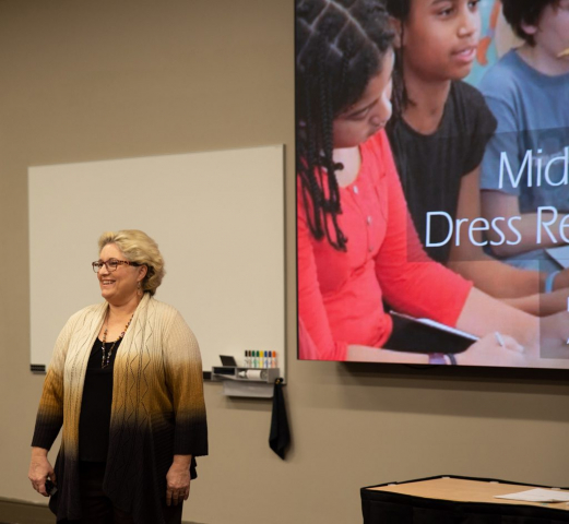 """Dr. Amanda Cassity presents the session """"Dress Rehearsal for Life"""" to middle school parents."""