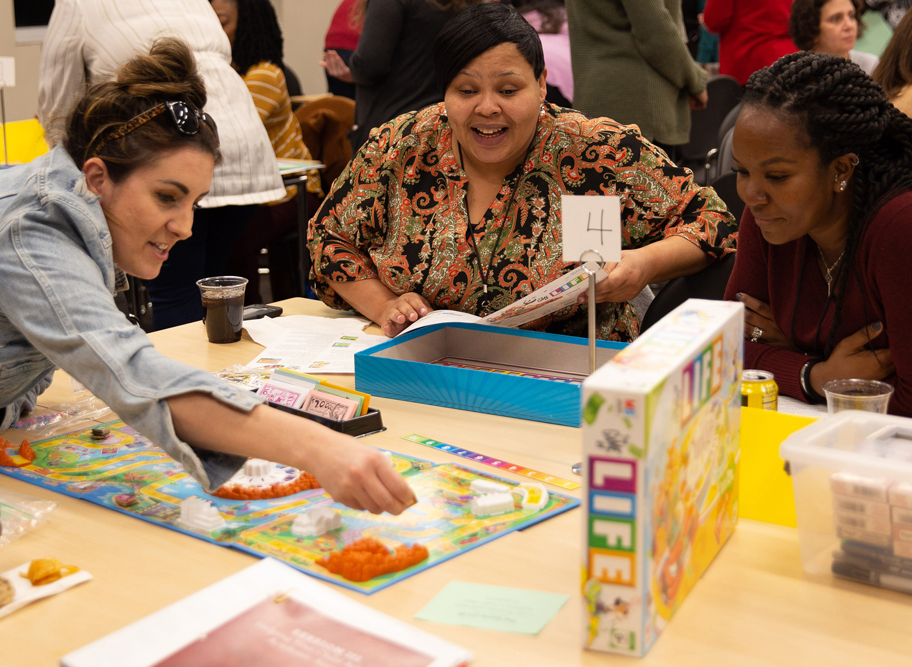 """Parents try their hand at math games during the """"Math Matters"""" session."""