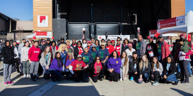 Members of the Saving Lives network pose with UA student organizations during the 2020 Tuscaloosa Heart Walk.
