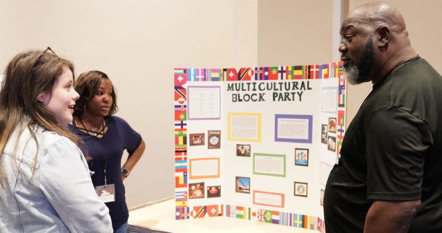 """University Place Elementary parents Tasha Nevels and Kenneth Lee introduce their project """"Multicultural Block Party."""""""
